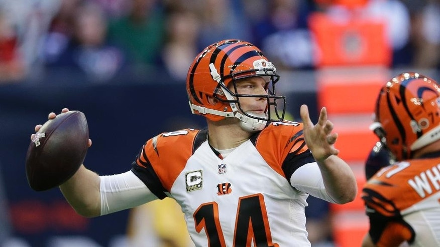 Cincinnati Bengals' Andy Dalton (14) throws against the Houston Texans during the first quarter of an NFL football game, Sunday, Nov. 23, 2014, in Houston. (AP Photo/David J. Phillip)
