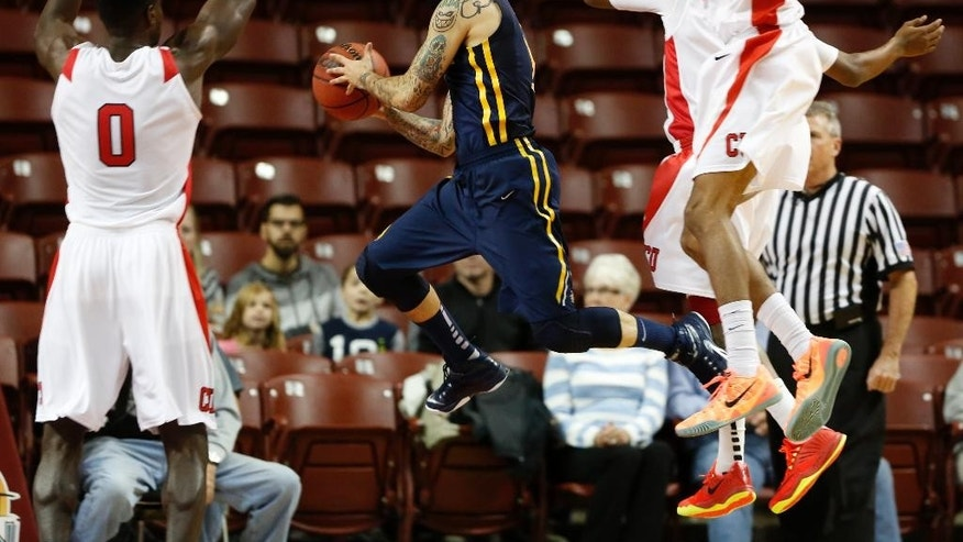 Drexel's Freddie Wilson, center, jumps through the defense of Cornell's David Onuorah, left, Shonn Miller, right, and Robert Hatter, back right, in the first half at the Charleston Classic NCAA college basketball tournament in Charleston, S.C., Sunday, Nov. 23, 2014. (AP Photo/Mic Smith)