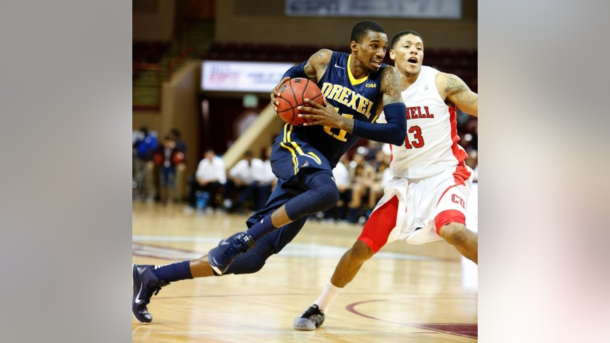 Drexel's Tavon Allen, left, drives to the basket against the defense of Cornell's Devin Cherry in the first half at the Charleston Classic NCAA college basketball tournament in Charleston, S.C., Sunday, Nov. 23, 2014. (AP Photo/Mic Smith)
