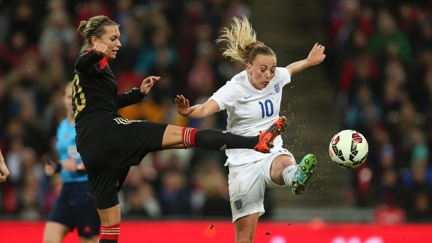 England's Toni Duggan and Germany's Lena Goeduring, left, in action during their International Friendly women's soccer match at Wembley Stadium in London, Sunday Nov. 23, 2014.  (AP Photo / Mike Egerton, PA) UNITED KINGDOM OUT - NO SALES - NO ARCHIVES