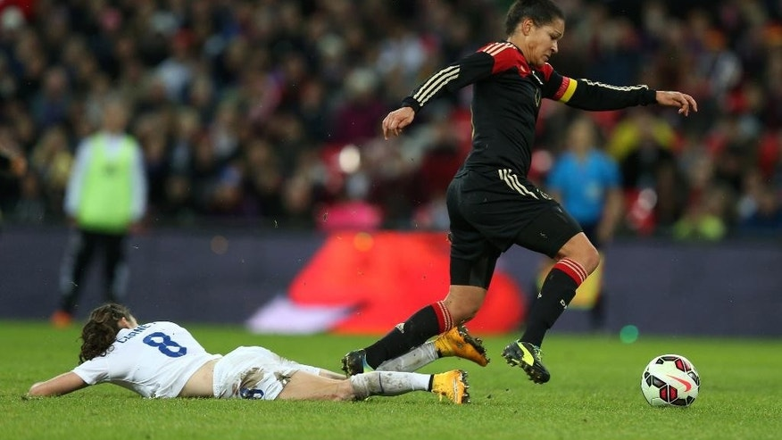 England's Karen Carney and Germany's Celia Sasic, right, battle for the ball during the International Friendly women's soccer match at Wembley Stadium, London, Sunday, Nov. 23, 2014. (AP Photo/Mike Egerton, PA Wire)    UNITED KINGDOM OUT    -   NO SALES    -   NO ARCHIVES