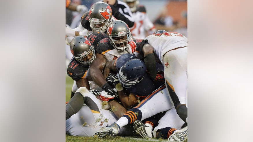 Chicago Bears running back Matt Forte is tackled by Tampa Bay Buccaneers defenders during the second half of an NFL football game Sunday, Nov. 23, 2014, in Chicago. The Bears won 21-13. (AP Photo/Nam Y. Huh)