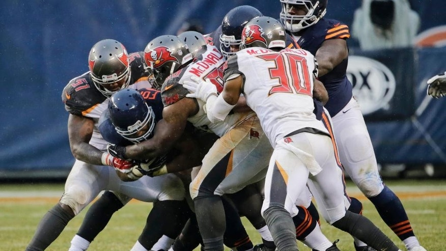 Chicago Bears running back Matt Forte (22) is tackled by Tampa Bay Buccaneers defenders during the second half of an NFL football game Sunday, Nov. 23, 2014, in Chicago. (AP Photo/Charles Rex Arbogast)
