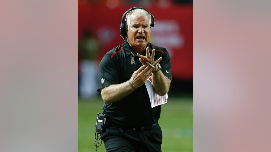 Atlanta Falcons head coach Mike Smith tries to call a time out during the first half of an NFL football game against the Cleveland Browns, Sunday, Nov. 23, 2014, in Atlanta. (AP Photo/John Bazemore)