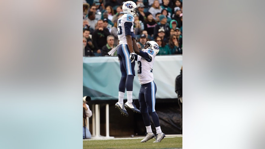 Tennessee Titans' Justin Hunter, left, and Kendall Wright celebrate after Hunter's touchdown during the first half of an NFL football game against the Philadelphia Eagles, Sunday, Nov. 23, 2014, in Philadelphia. (AP Photo/Matt Rourke)