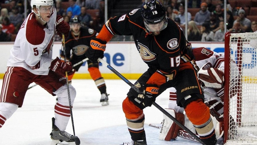 Anaheim Ducks left wing Patrick Maroon (19) controls the puck with Arizona Coyotes defenseman Connor Murphy (5) looks on during the second period of an NHL hockey game in Anaheim, Calif., Sunday, Nov. 23, 2014. (AP Photo/Alex Gallardo)