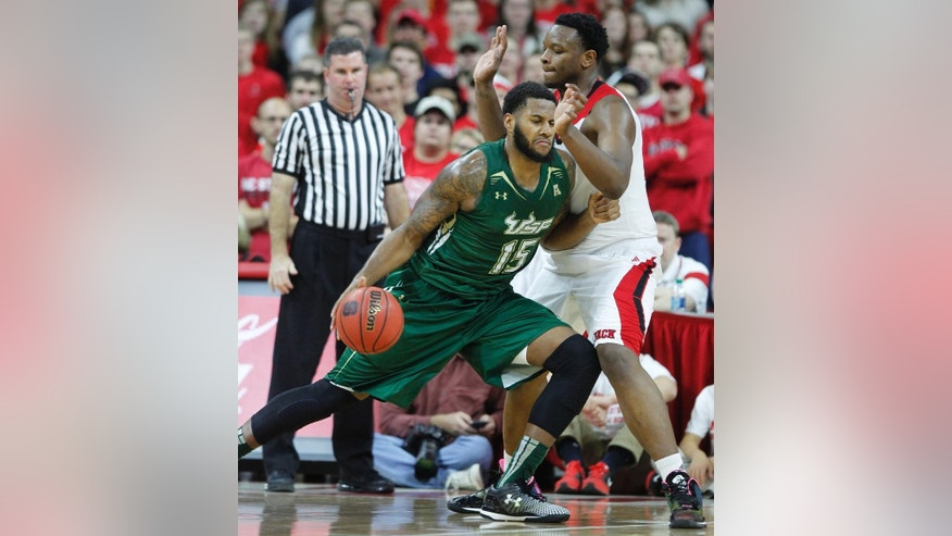 North Carolina State's Beejay Anya (21) defends against South Florida's Jaleel Cousins (15) during the first half  of an NCAA college basketball game in Raleigh, N.C., Sunday, Nov. 23, 2014. (AP Photo/The News & Observer, Ethan Hyman)  MANDATORY CREDIT