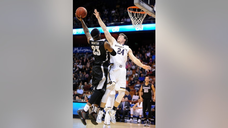 Providence's LaDontae Henton (23) shoots over Notre Dame's Pat Connaughton during the first half of an NCAA college basketball game in Uncasville, Conn., on Sunday, Nov. 23, 2014. (AP Photo/Fred Beckham)