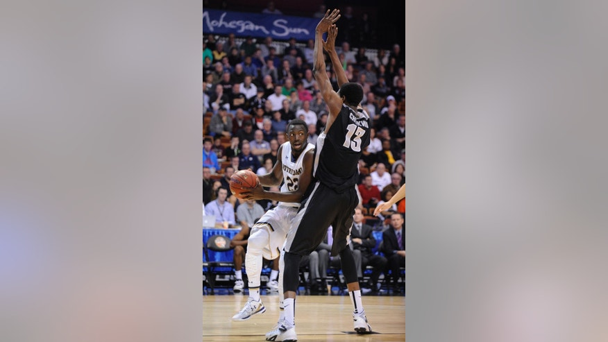 Notre Dame's Jerian Grant (22) drives past Providence's Paschal Chukwu during the first half of an NCAA college basketball game in Uncasville, Conn., on Sunday, Nov. 23, 2014. (AP Photo/Fred Beckham)