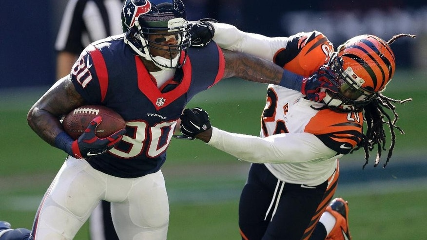 Houston Texans' Andre Johnson (80) is defended by Cincinnati Bengals' Reggie Nelson (20) following a reception during the second quarter of an NFL football game, Sunday, Nov. 23, 2014, in Houston. (AP Photo/David J. Phillip)