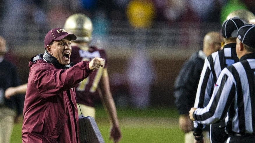 Florida State head coach Jimbo Fisher disagrees with a call in the second half of an NCAA college football game against Boston College in Tallahassee, Fla., Saturday, Nov. 22, 2014. (AP Photo/Mark Wallheiser)