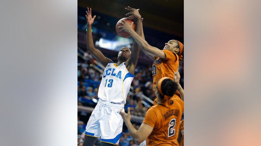 UCLA center Luiana Livulo (13) battles Texas guard Brianna Taylor, right, in the first half of an NCAA college basketball game in Los Angeles, Sunday, Nov. 23, 2014. (AP Photo/Christine Cotter)