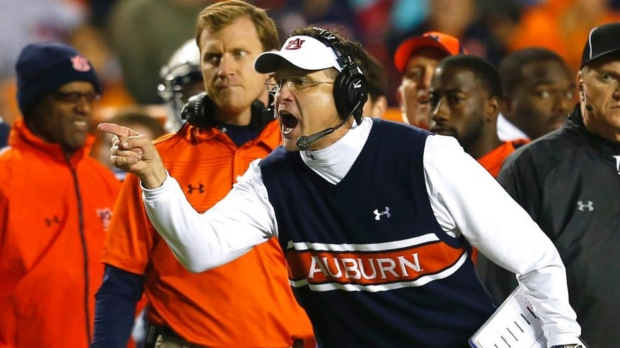 Auburn coach Gus Malzahn reacts to a call during the second half of an NCAA college football game against Samford on Saturday, Nov. 22, 2014, in Auburn, Ala. (AP Photo/Butch Dill)