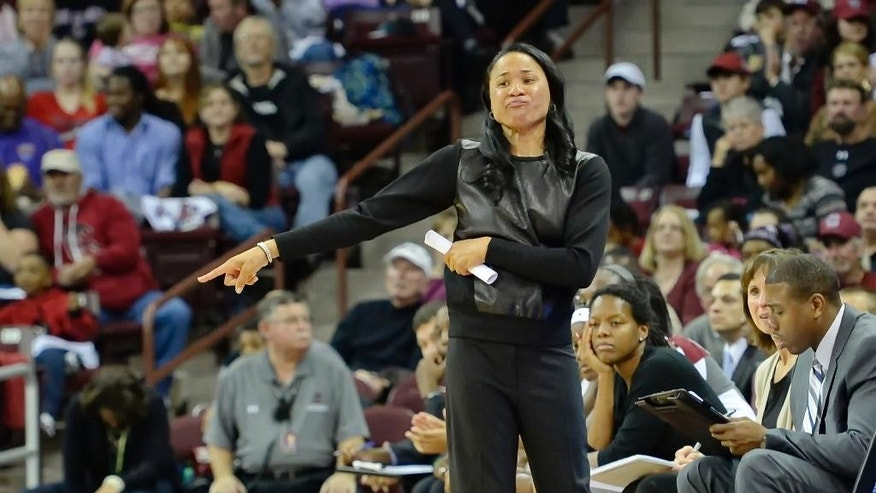 South Carolina head coach Dawn Staley reacts during the first half of an NCAA college basketball game against San Diego State, Sunday, Nov. 23, 2014, in Columbia, S.C. (AP Photo/Richard Shiro)