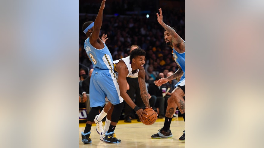 Denver Nuggets guard Ty Lawson (3) and forward Wilson Chandler, right, double team Los Angeles Lakers forward Nick Young, center, in the first half of an NBA basketball game, Sunday, Nov. 23, 2014, in Los Angeles.(AP Photo/Gus Ruelas)