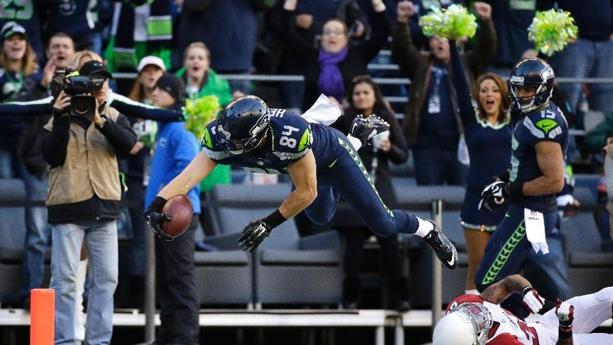 Seattle Seahawks tight end Cooper Helfet dives for a touchdown in the second half of an NFL football game against the Arizona Cardinals, Sunday, Nov. 23, 2014, in Seattle. (AP Photo/Elaine Thompson)