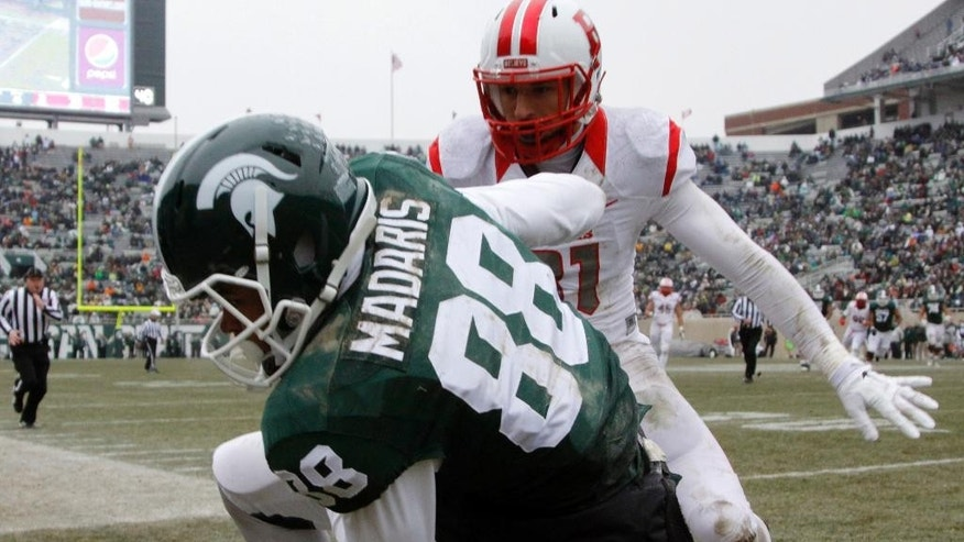Michigan State's Monty Madaris (88) is pushed out of bounds by Rutgers' Anthony Cioffi after a 24-yard reception during the fourth quarter of an NCAA college football game, Saturday, Nov. 22, 2014, in East Lansing, Mich. Michigan State won 45-3. (AP Photo/Al Goldis)