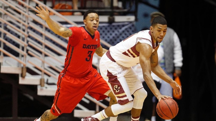 Boston College guard Olivier Hanlan, right, dribbles against Dayton guard Kyle Davis during a NCAA college basketball game in San Juan, Puerto Rico, Sunday, Nov. 23, 2014. (AP Photo/Ricardo Arduengo)