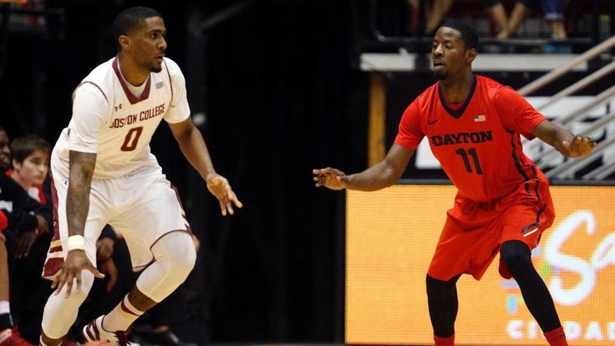 Boston College forward Garland Owens, left, dribbles against Dayton guard Scoochie Smith during a NCAA college basketball game in San Juan, Puerto Rico, Sunday, Nov. 23, 2014. (AP Photo/Ricardo Arduengo)
