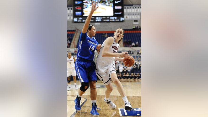 Connecticut's Breanna Stewart, right, dribbles around Creighton's Sydney Lamberty, left, during the second half of an NCAA women's college basketball game, Sunday, Nov. 23, 2014, in Storrs, Conn. Connecticut won 96-60. (AP Photo/Jessica Hill)