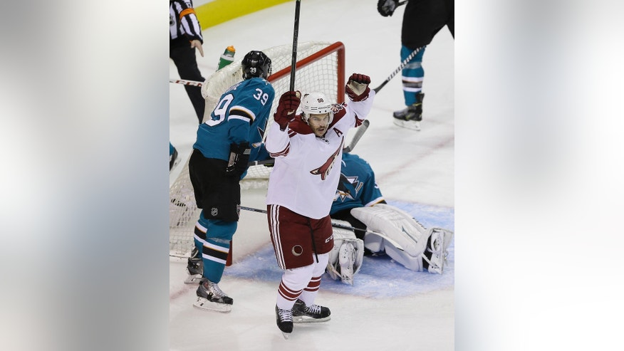 Arizona Coyotes center Antoine Vermette reacts after scoring a power play goal during the first period of an NHL hockey game against the San Jose Sharks Saturday, Nov. 22, 2014, in San Jose, Calif. In the background are San Jose Sharks center Logan Couture (39) and goalie Antti Niemi.  (AP Photo/Eric Risberg)