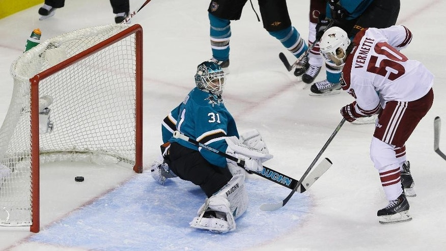 Arizona Coyotes center Antoine Vermette, right, scores a power play goal against San Jose Sharks goalie Antti Niemi, left, during the first period of an NHL hockey game Saturday, Nov. 22, 2014, in San Jose, Calif. (AP Photo/Eric Risberg)