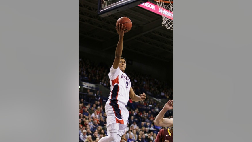Gonzaga's Angel Nunez (2) takes a layup against St. Thomas Aquinas during the second half of an NCAA college basketball game in Spokane, Wash., Saturday, Nov. 22, 2014. Gonzaga won 109-55. (AP Photo/Young Kwak)