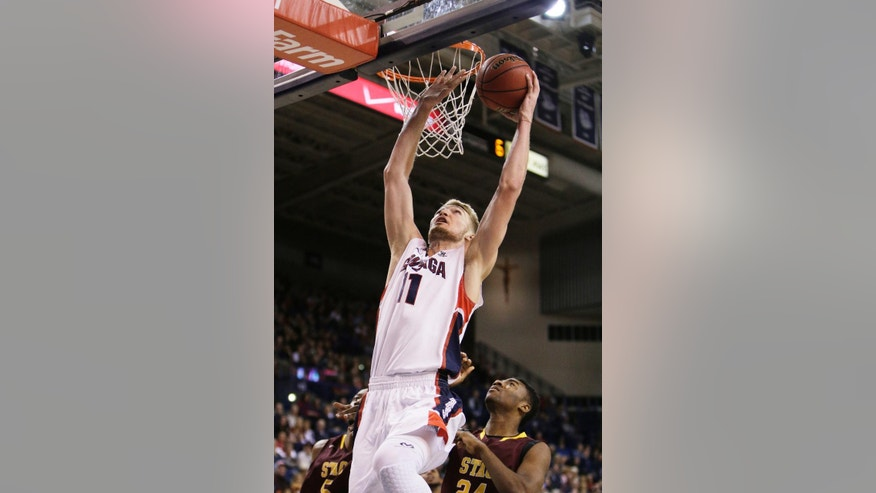 Gonzaga's Domantas Sabonis (11) shoots a layup against St. Thomas Aquinas during the second half of an NCAA college basketball game in Spokane, Wash., Saturday, Nov. 22, 2014. Gonzaga won 109-55. (AP Photo/Young Kwak)