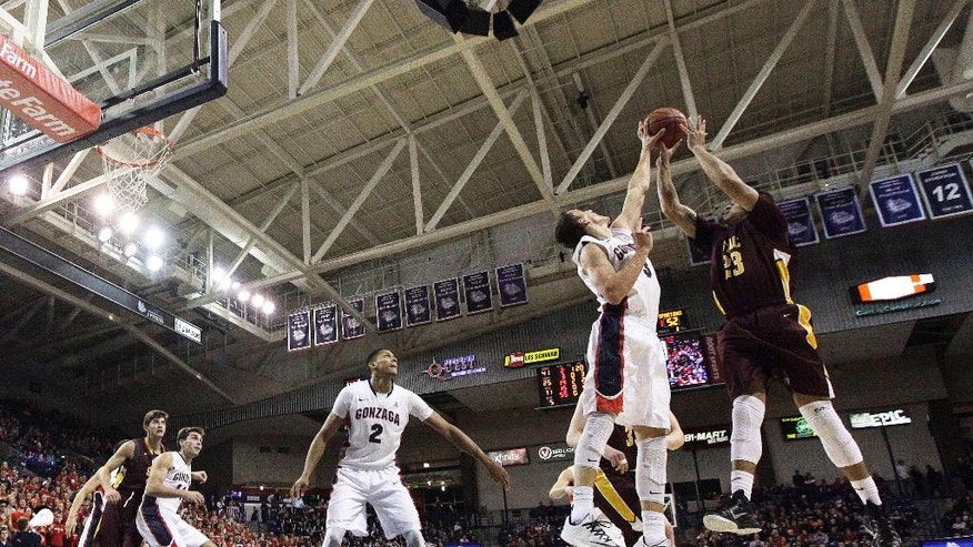 St. Thomas Aquinas' Matthew Lee (23) has his shot blocked by Gonzaga's Kyle Dranginis during the second half of an NCAA college basketball game in Spokane, Wash., Saturday, Nov. 22, 2014. Gonzaga won 109-55. (AP Photo/Young Kwak)