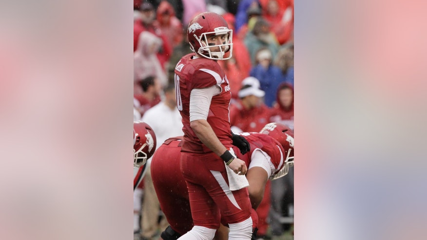 In this Nov. 22, 2014, photo Arkansas quarterback Brandon Allen prepares for a play against Mississippi in the first quarter of an NCAA college football game in Fayetteville, Ark. Arkansas gained bowl eligibility with its dominating win over Mississippi last week. but the Razorbacks must get Allen healthy before Friday's game at Missouri. (AP Photo/Danny Johnston)