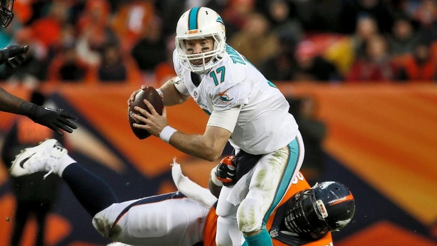 Miami Dolphins quarterback Ryan Tannehill (17) is sacked by Denver Broncos defensive tackle Terrance Knighton during the second half of an NFL football game, Sunday, Nov. 23, 2014, in Denver. (AP Photo/Joe Mahoney)
