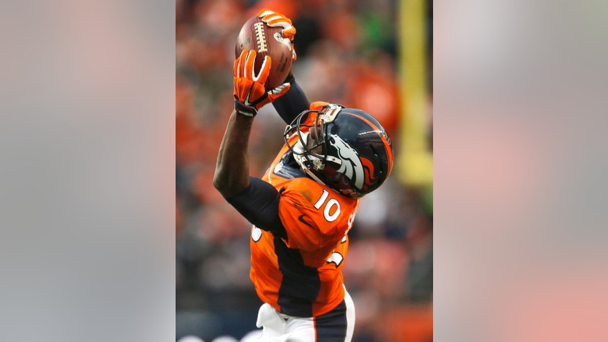 Denver Broncos wide receiver Emmanuel Sanders (10) makes a catch against the Miami Dolphins during the first half of an NFL football game, Sunday, Nov. 23, 2014, in Denver. (AP Photo/Joe Mahoney)