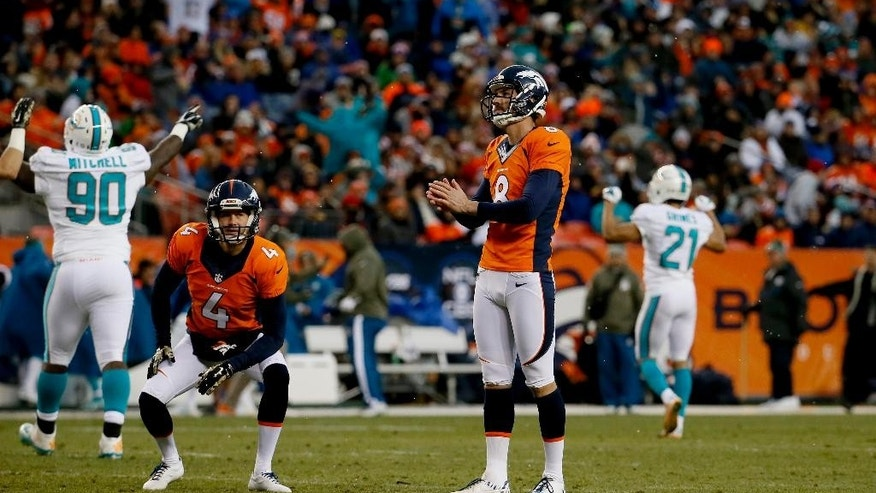 Denver Broncos kicker Brandon McManus (8) watches as he misses a field goal against the Miami Dolphins during the second half of an NFL football game, Sunday, Nov. 23, 2014, in Denver. (AP Photo/Jack Dempsey)