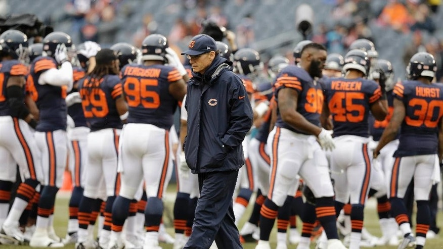 Chicago Bears head coach Marc Trestman walks down the field before an NFL football game against the Tampa Bay Buccaneers Sunday, Nov. 23, 2014, in Chicago. (AP Photo/Nam Y. Huh)