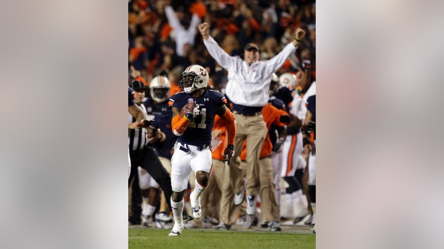 "FILE - In this Nov. 30, 2013, file photo, Auburn cornerback Chris Davis (11) returns a missed field goal attempt 100-plus yards to score the game-winning touchdown as time expired in the fourth quarter of an NCAA college football game against Alabama in Auburn, Ala. Alabama players have agonized over the Iron Bowl's ending, and the Auburn Tigers get giddy at replaying that memorable ""one second"" that turned their seasons. (AP Photo/Dave Martin, File)"