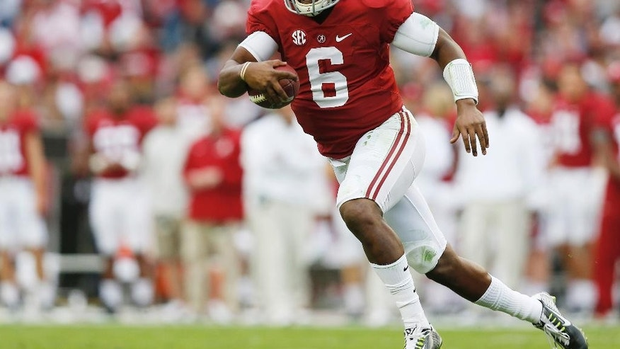 Alabama quarterback Blake Sims (6) runs the ball during the first half of an NCAA college football game against Western Carolina, Saturday, Nov. 22, 2014, in Tuscaloosa, Ala. (AP Photo/Brynn Anderson)
