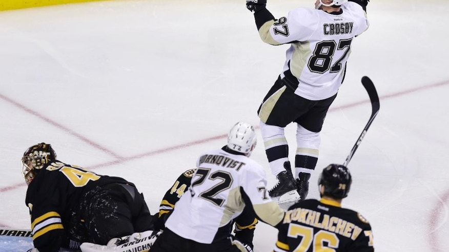 Pittsburgh Penguins center Sidney Crosby (87) celebrates after his goal during the first period of an NHL hockey game against the Boston Bruins in Boston, Monday, Nov. 24, 2014. (AP Photo/Charles Krupa)