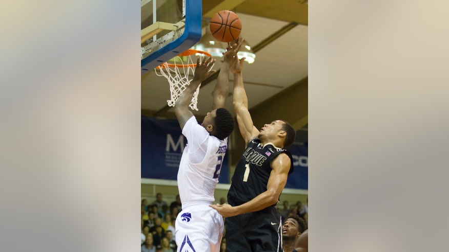 Kansas State guard Marcus Foster (2) has his shot blocked by Purdue guard Bryson Scott (1) in the first half of an NCAA college basketball game at the Maui Invitational on Monday, Nov. 24, 2014, in Lahaina, Hawaii. (AP Photo/Eugene Tanner)