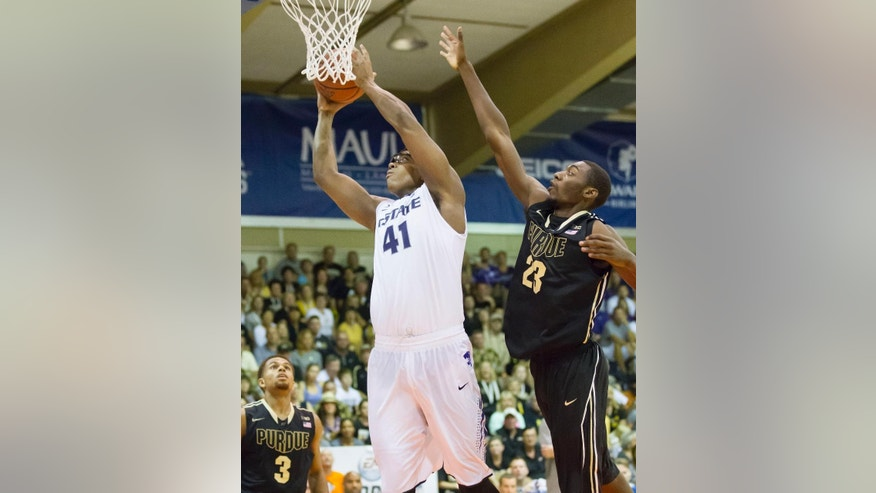 Kansas State forward Stephen Hurt (41) shoots a layup while being defended by Purdue forward Jacquil Taylor (23) in the first half of an NCAA college basketball game at the Maui Invitational on Monday, Nov. 24, 2014, in Lahaina, Hawaii. Purdue guard P.J. Thompson (3) looks on at left. (AP Photo/Eugene Tanner)