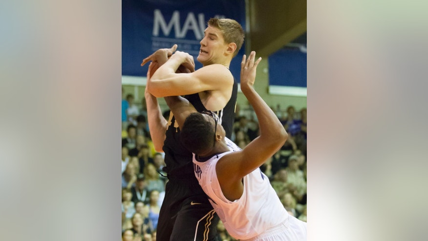 Purdue center Isaac Haas, top, battles Kansas State forward Stephen Hurt, bottom, for a rebound in the first half of an NCAA college basketball game at the Maui Invitational on Monday, Nov. 24, 2014, in Lahaina, Hawaii. (AP Photo/Eugene Tanner)