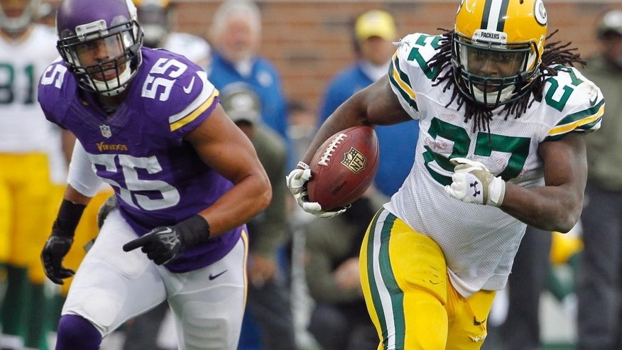 Green Bay Packers running back Eddie Lacy, right, runs from Minnesota Vikings outside linebacker Anthony Barr (55) during the second half of an NFL football game, Sunday, Nov. 23, 2014, in Minneapolis. (AP Photo/Ann Heisenfelt)