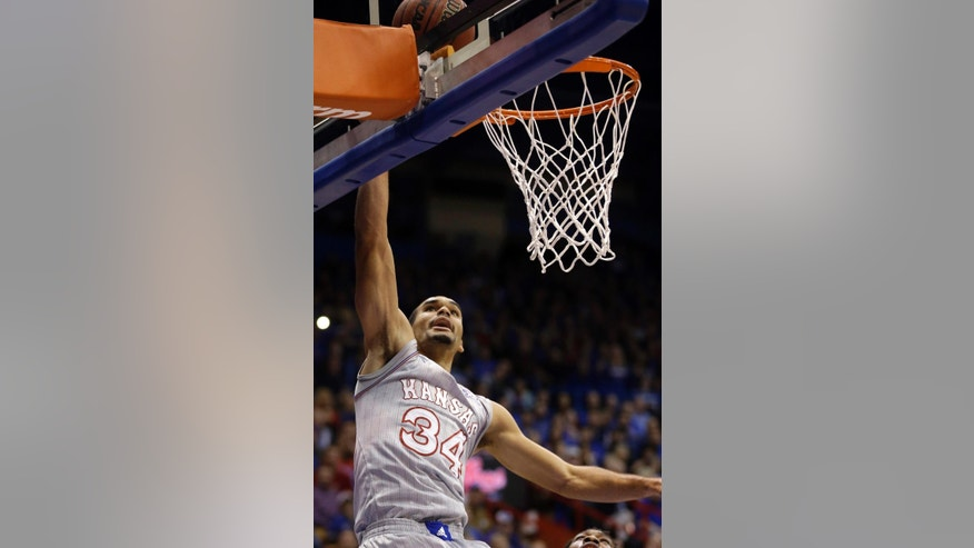 Kansas forward Perry Ellis makes a basket during the first half of an NCAA college basketball game against Rider in Lawrence, Kan., Monday, Nov. 24, 2014. Kansas defeated Rider 87-60. (AP Photo/Orlin Wagner)