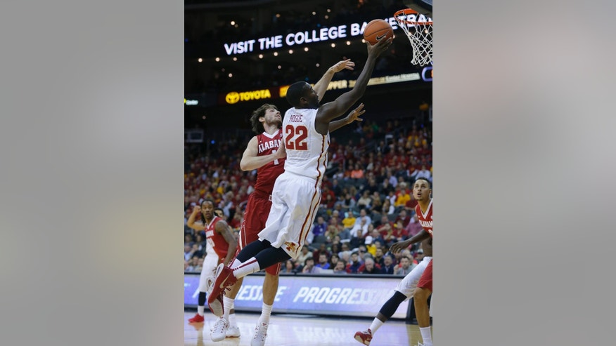 Iowa State forward Dustin Hogue (22) shoots past Alabama forward Riley Norris (1) in the first half of the CBE Hall of Fame Classic college baseball game Monday, Nov. 24, 2014, in Kansas City, Mo. (AP Photo/Ed Zurga)