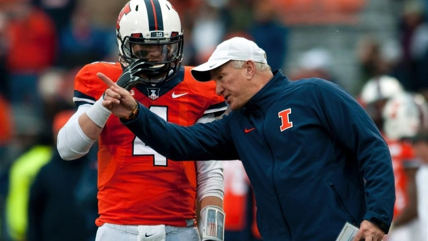Illinois offensive coordinator Bill Cubit, right, talks to Illinois quarterback Reilly O'Toole (4) during the fourth quarter of an NCAA football game against Penn State, Saturday, Nov. 22, 2014, at Memorial Stadium in Champaign, Ill. (AP Photo/Bradley Leeb)