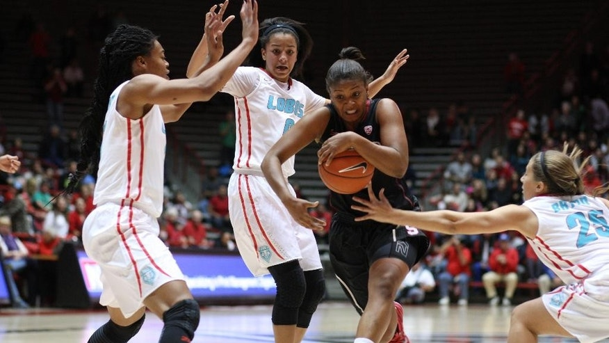 Stanford guard Amber Orrange, second from right, brings the ball through heavy traffic during an NCAA college basketball game against New Mexico in Albuquerque, N.M., Monday, Nov. 24, 2014. (AP Photo/Mark Holm)