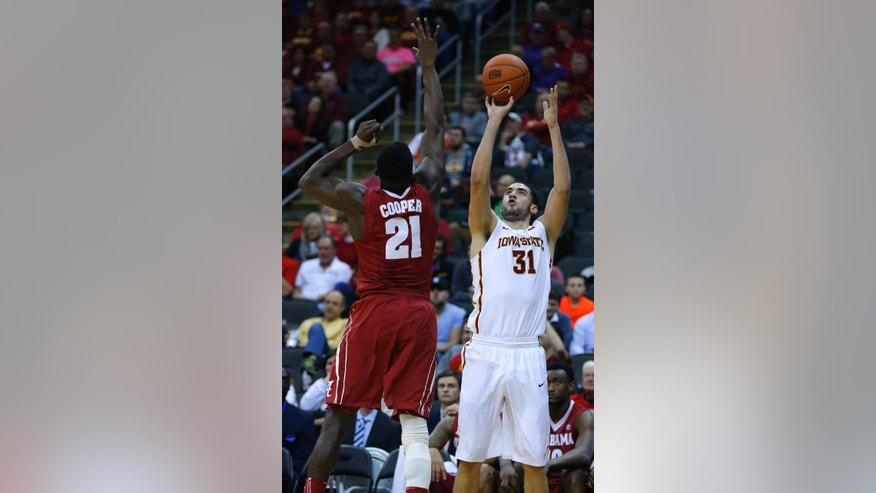 Iowa State forward Georges Niang (31) shoots over Alabama guard Rodney Cooper (21) in the first half of the CBE Hall of Fame Classic college baseball game Monday, Nov. 24, 2014, in Kansas City, Mo. (AP Photo/Ed Zurga)