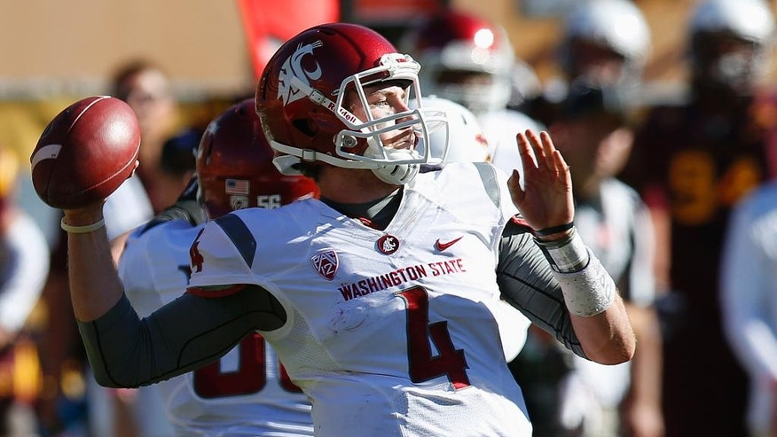 Washington State's Luke Falk throws a pass against Arizona State during the second half of an NCAA college football game, Saturday, Nov. 22, 2014, in Tempe, Ariz. Arizona State defeated Washington State 52-31. (AP Photo/Ross D. Franklin)