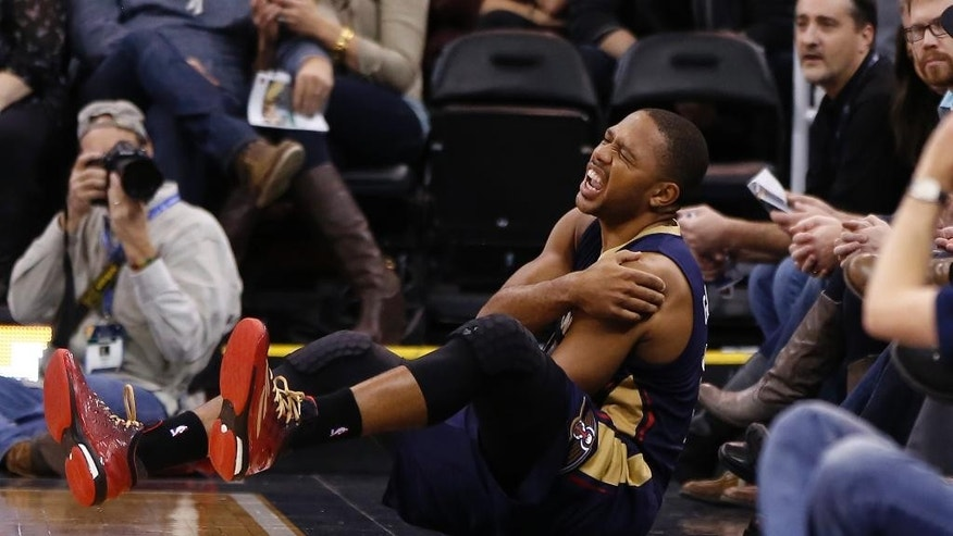 New Orleans Pelicans guard Eric Gordon (10) reacts after being injured during the first half of their NBA Basketball game against the Utah Jazz in Salt Lake City, Utah, Saturday, Nov. 22, 2014. (AP Photo/Jim Urquhart)