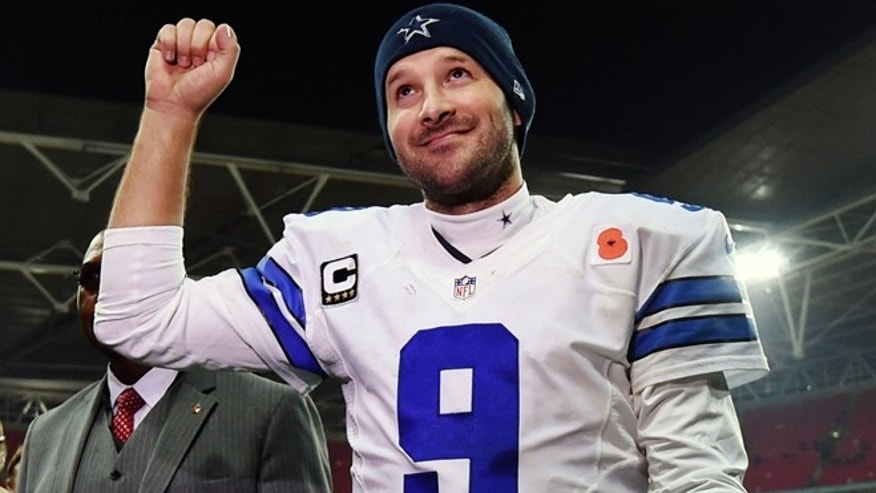 FILE - In this Nov. 9, 2014, file photo, Dallas Cowboys quarterback Tony Romo acknowledges spectators after the team's 31-17 victory over the Jacksonville Jaguars in an NFL football game at Wembley Stadium in London. Romo will play the New York Giants on Sunday night, Nov. 23, then figure out if his surgically repaired back can hold up for the quick Thanksgiving turnaround. (AP Photo/Tim Ireland, File)