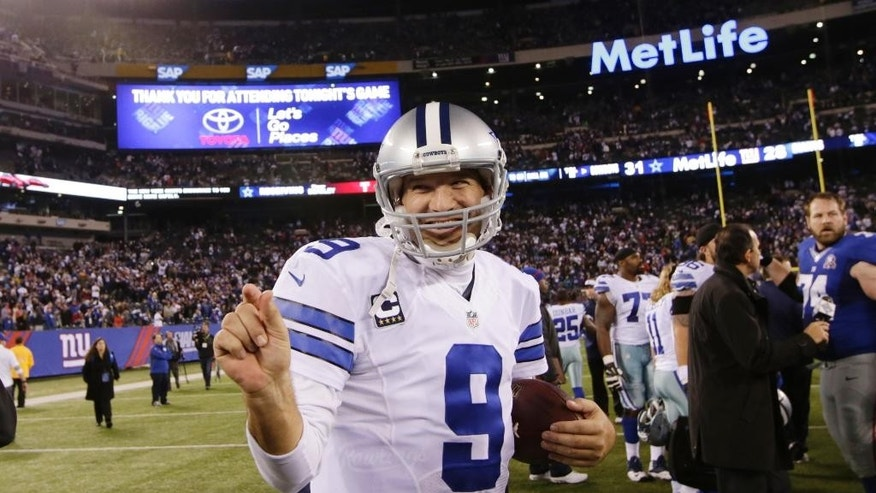 Dallas Cowboys quarterback Tony Romo (9) reacts after beating the New York Giants 31-28 in an NFL football game, Sunday, Nov. 23, 2014, in East Rutherford, N.J. (AP Photo/Kathy Willens)